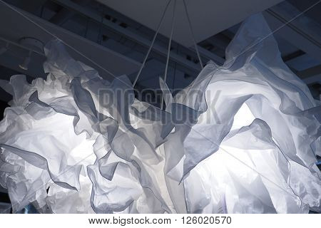 Backgroung paper lamp disastrously hanging white and blue photo to soft blur