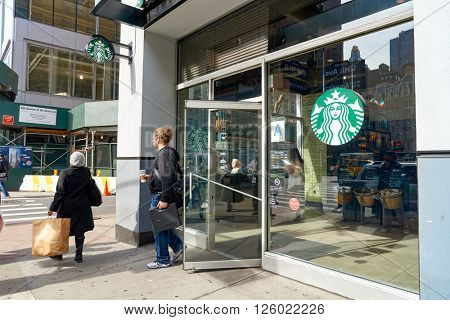 NEW YORK - CIRCA MARCH 2016: entryway of Starbucks Cafe. Starbucks Corporation is an American global coffee company and coffeehouse chain based in Seattle, Washington