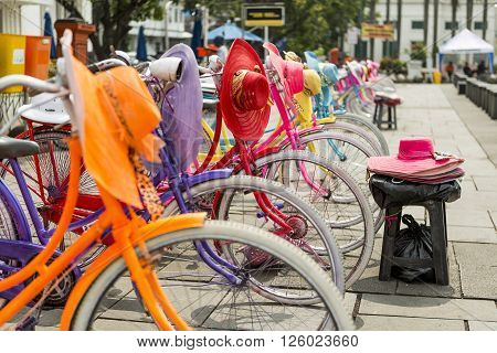 Colorful bicycles lined up on Fatahilah Square in Jakarta's Old Town.
