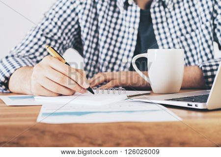 Man Writing In Notepad Front
