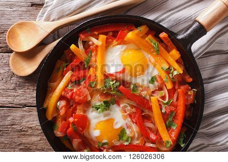 Basque Breakfast: Fried Eggs With Peppers Close-up. Horizontal Top View
