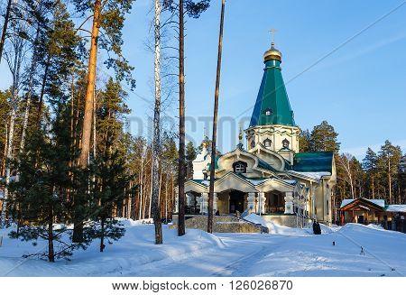 wooden church in woods in winter Ural Ekaterinburg Ganin Yama