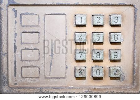 Old button number public telephone, Close up image