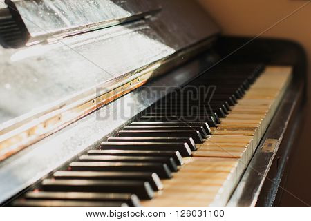 Detail of old rusty piano keyboard, selective focus