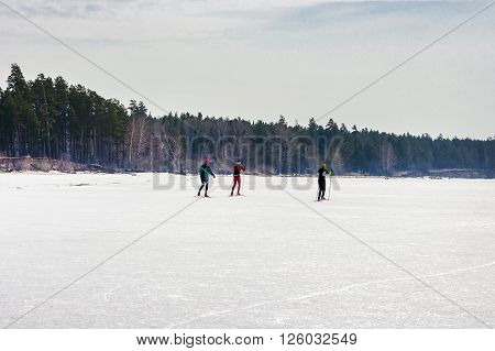 Berdsk Novosibirsk region Siberia the Ob river Russia - April 17 2016: the skiers are running along the ice of the Ob river