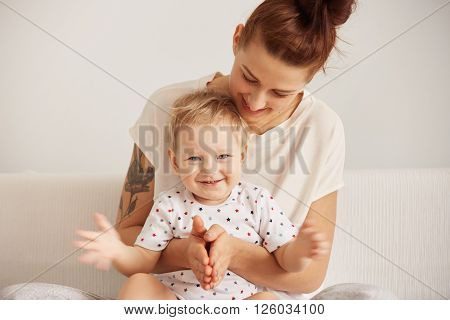 Portrait Of Redhead Mother Having Fun With Her Blond Son Indoor With Toddler Looking At The Camera W