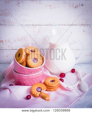 Berry Cookies With Milk On Wooden Background