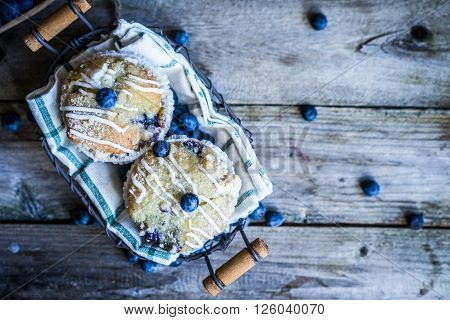 Image of Blueberry muffins on rustic background