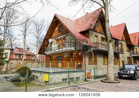 ZAKOPANE POLAND - MARCH 09 2016: Holiday House called Sienkiewiczowka 2 building with elements of Zakopane style offers accomodation for tourists coming to town.
