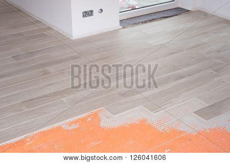 floor renovation with ceramic tiles in wood design