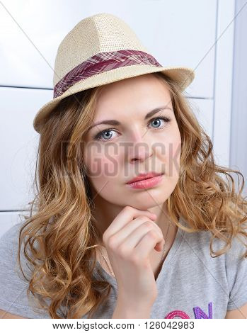 Portrait of young serious looking woman isolated on the white background.