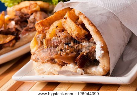 Image of gyros pita in low key technique