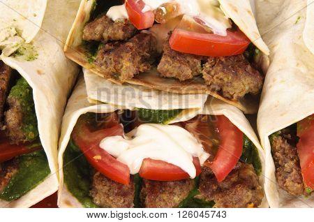 Image of kebabs and vegetables in tortila