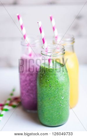 Three Smoothies With Berries on Rustic Background ** Note: Shallow depth of field