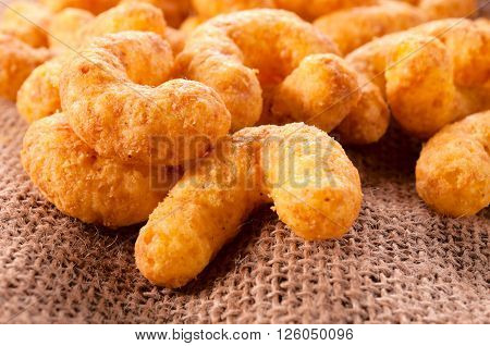Image of unhealthy snacks with cheese and peanuts