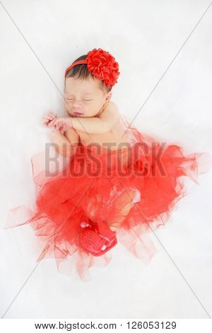 Sleeping newborn baby girl. Dreams and happiness concept