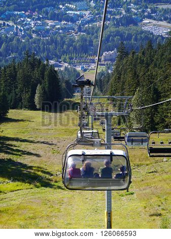 WHISTLER, BC, CANADA : August 18 2015. Visitors Riding the Chairlift on Blackcomb Mountain. Whistler, BC, Canada. August 18 2015
