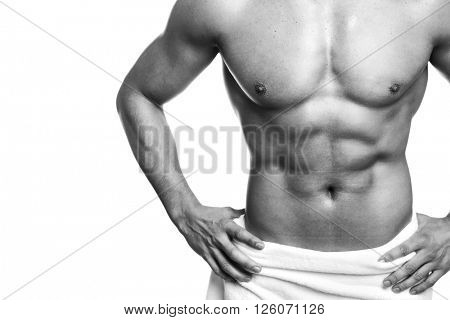 Muscled young man posing in towel (black and white edition) , isolated over white background