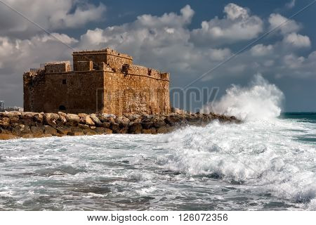PAPHOS, CYPRUS - MARCH 16, 2016:Paphos Castle represents one of the most distinctive landmarks of the city of Paphos Cyprus