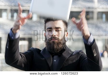 Young Hipster Pulling The Laptop In The Air