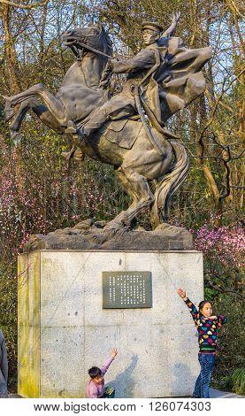 HANGZHOU, CHINA - FEBRUARY 17, 2016 Two students Revolutionary Statue Qimei Chen Horse Statue West Lake Hangzhou Zhejiang China . Qimei Chen was a followerof Sun Yat-Sen died in the early 1900s