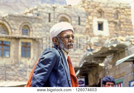 SANAA YEMEN - JUNE 30 1991: portrait of old senior man with the typical yemenite dress The turban and the neck scarf in Sanaa Yemen