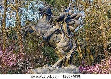 HANGZHOU, CHINA - FEBRUARY 17, 2016 Revolutionary Statue Qimei Chen Horse Statue West Lake Hangzhou Zhejiang China . Qimei Chen was a follower of Sun Yat-Sen died in the early 1900s