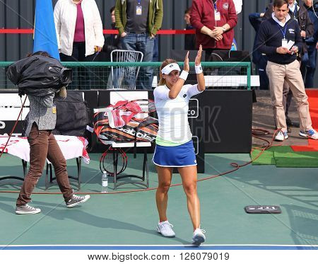 KYIV UKRAINE - APRIL 16 2016: Lesia Tsurenko of Ukraine reacts after won the BNP Paribas FedCup match against Nadia Podoroska of Argentina at Campa Bucha Tennis Club in Kyiv Ukraine