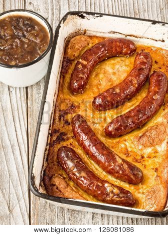 close up of rustic english pub grub toad in the hole