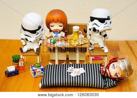 BANGKOK, THAILAND - April 11, 2016 : Stormtroopers and Ironman figure model setup in Late night party, The stormtroopers and Ironman are the famous character in the movies