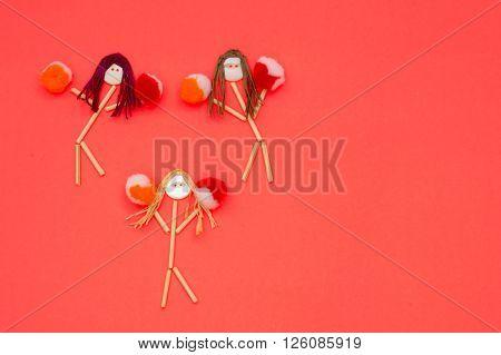 Cheerleader buttonhead stick figure girls orange and red pompoms