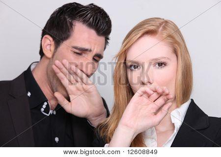 Man and woman yawning