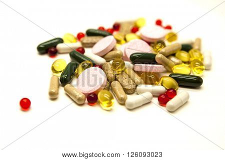 Different pills, medications, the pills  closeup on white background