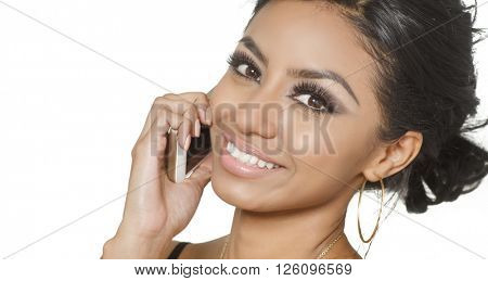 Smelling happy positive young woman talking on cell phone