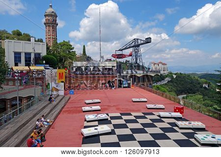 BARCELONA, SPAIN - AUGUST 1, 2015: View of Tibidabo Amusement Park built by the entrepreneur Salvador Andreu and opened in 1899. The park is one of the oldest in the world that is still functioning.