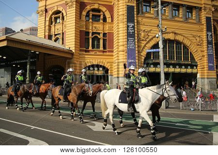 MELBOURNE, AUSTRALIA - JANUARY 25, 2016: Victorian Police Mounted Branch Constables providing security during Australia Day Parade in Melbourne