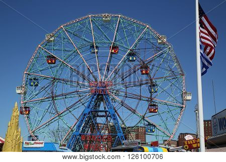 BROOKLYN, NEW YORK - APRIL 10, 2016: Wonder Wheel at the Coney Island amusement park. Deno's Wonder Wheel a hundred and fifty foot eccentric Ferris wheel. This wheel was built in 1920