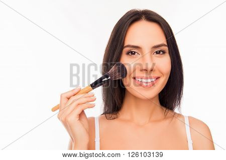 Nice Smiling Young Woman Holding Makeup Brush