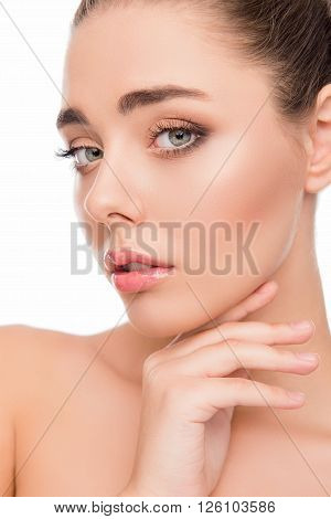 Close Up Portrait Of Sensitive Young Woman Touching Her Chin