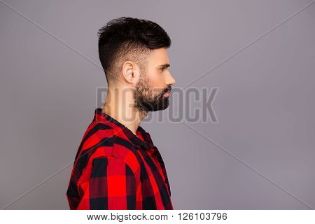 Side View Portrait Os Serious Minded Man In Red Checkered Shirt