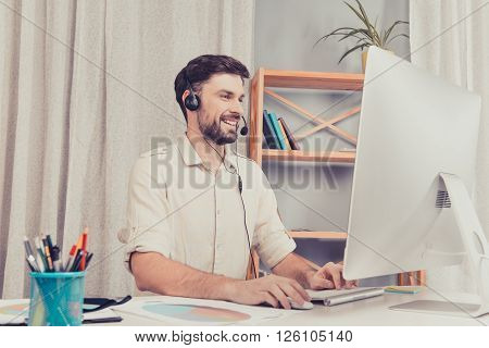 Happy Cheerful Young Worker Of Call Center In Head-phones