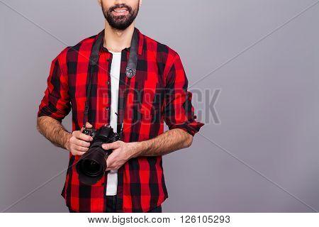 Close Up Photo Of Young Successful Cameraman Holding Camera
