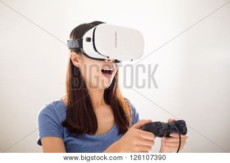 Woman looking though virtual reality with joystick