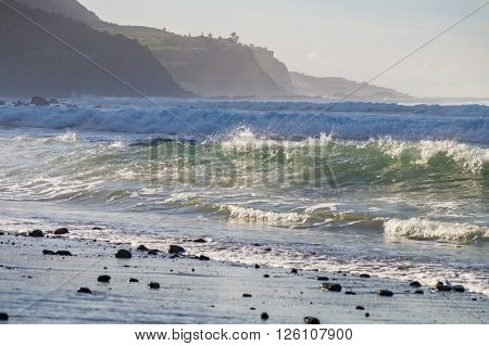 Rocks and stormy waves on Playa El Socorro beach Tenerife Canary Islands Spain