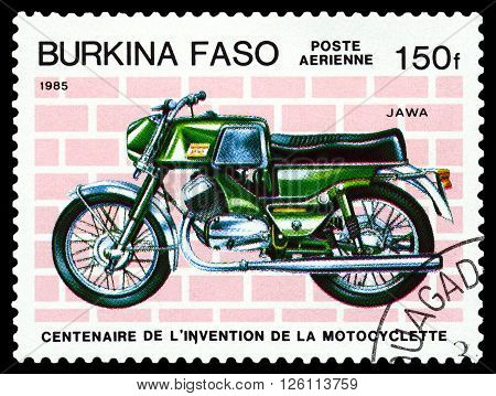 STAVROPOL RUSSIA - MARCH 16 2016: a stamp printed in Burkina Faso shows an old motorcycle Jawa stamp devoted to the centenary of the invention of motorcycle circa 1985