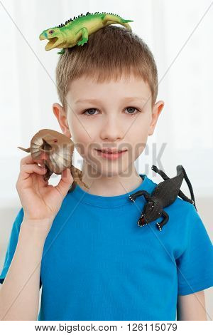 Portrait Of A Boy Playing With Dinosaur