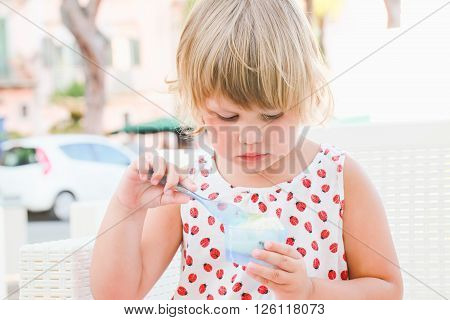 Cute Baby Girl Eats Frozen Yogurt With Ice Cream
