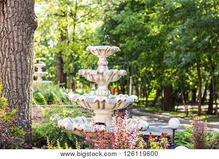 Beautiful fountain multi-tiered  in the green park.