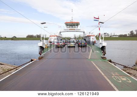 Culemborg, Netherlands, 11 april 2016: cars on ferryboat on river rhine at Wijk bij Duurstede in the netherlands