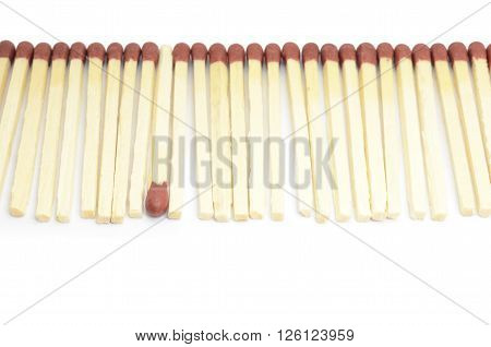 Uniqueness concept idea, one matchstick in opposite direction from others, with shallow depth of field